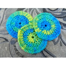 Three Hand Crocheted Acrylic Face Scrubbies.  Approx 4 inches in diameter.